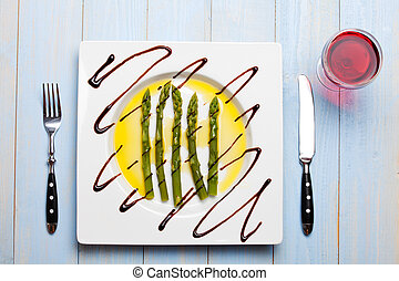 green asparagus on a white plate