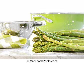 Green asparagus on marble table - Fresh green asparagus on...