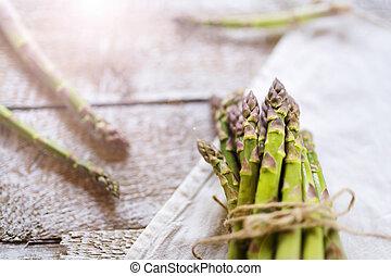 Green asparagus - Bunch of fresh green asparagus spears tied...