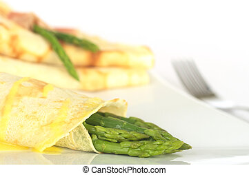 Green asparagus wrapped in crepes with Hollandaise sauce on...