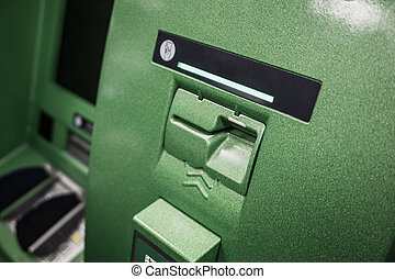 Green ATM machine or Cashpoint Machine, slot for credit card. close up image