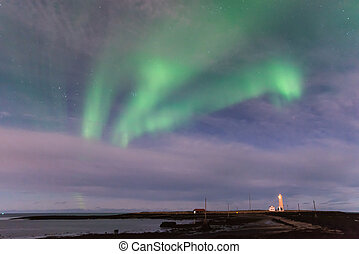 Green Aurora Borealis over the Grotta Lighthouse in Iceland
