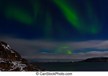 Green aurora over the Arctic Ocean