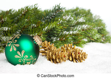 green ball with golden pinecone