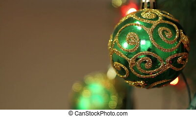green ball with sparkles on a Christmas tree