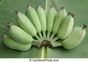 Green banana on banana leaf