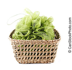 Green bath loofah in a basket