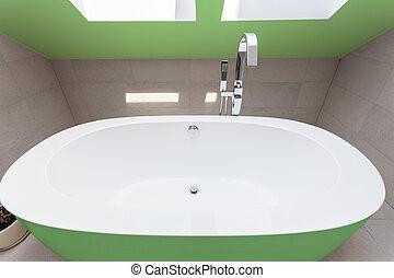 Green bathtub in bathroom