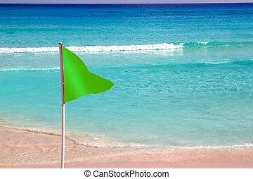Green beach flag good beach weather - Green beach flag in...
