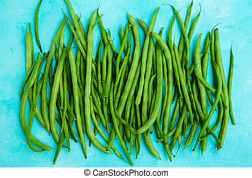 Green beans on blue background. Close up. Top view.