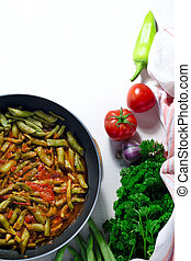 green beans with tomatoes lobio souce in Frying pan on white background.