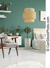 Green bedroom interior with lamp