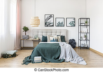 Green bedroom interior with plant