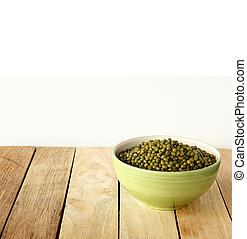 green beens are on wooden background.