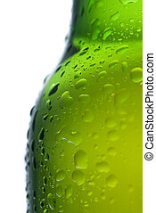 Green beer bottle with water drops isolated on white