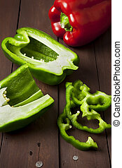 Green bell pepper cut in half and slices