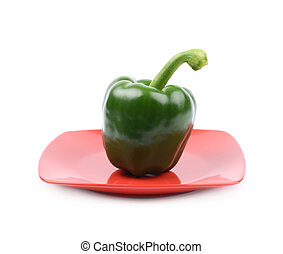Green bell pepper on a plate