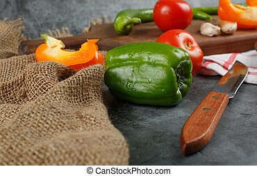 Green bell pepper on a rustic background.