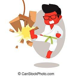 green belt red karate kid breaking board