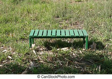 green bench on the grass field