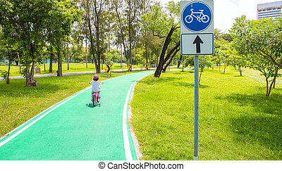 Green bicycle path in the park