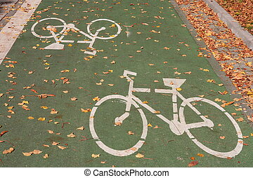 Green bicycle track with white sign