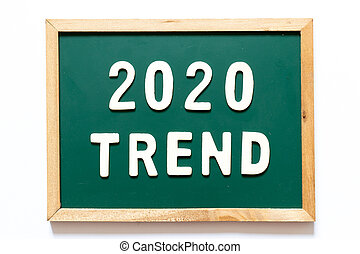 Green blackboard and wood frame with word 2020 trend on white background