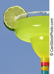 Green & Blue Flavor - a margarita with a lime against a dark...