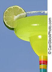Green & Blue Flavor - a margarita with a lime against a dark...