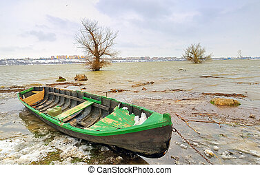 green boat on danube river