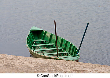 Green boat on the berth