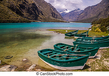 Green boats at glacier lagoon in Peruvian Andes - Huaraz,...