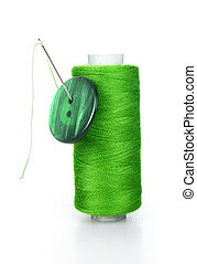 Green bobbin with needle and buttons