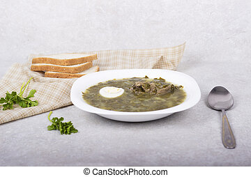 Green borsch with sorrel and boiled eggs