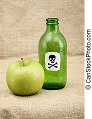 Green bottle and green apple