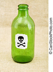 Green bottle with sticker skull and crossbones