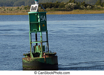 Green bouy - A large green bouy in the water to mark the ...