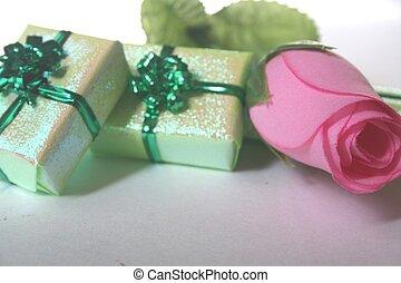 green boxes and rose