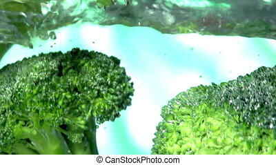 Green Broccoli Florets - Green broccoli florets slowly fall...