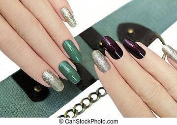 Green brown manicure.