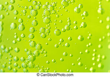 Green Bubbles - Bubbles in Green Soda Pop for a Background