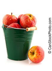Green bucket with red apples