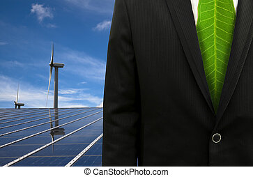 Green Business and eco energy.bussinessman with leaf tie and solar panel and windmill