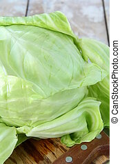 Green cabbage on the wooden table