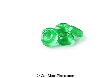 Green candies isolated on white