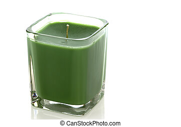 Green candle on white with clipping path
