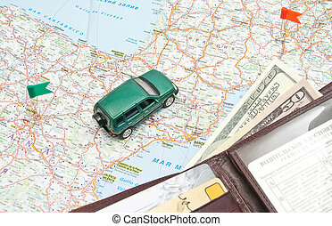 green car and wallet on the map