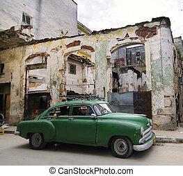 Green car on eroded havana street, cuba - Green classic...