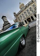 Green car perspective in havana, cuba