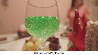 green carbonated lemonade in a glass close up.